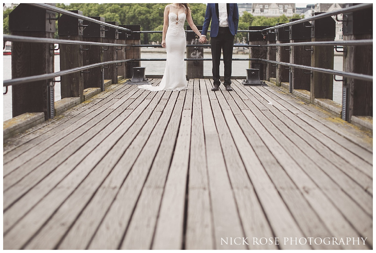 Pre wedding photography portrait on a jetty at London's Southbank along the River Thames