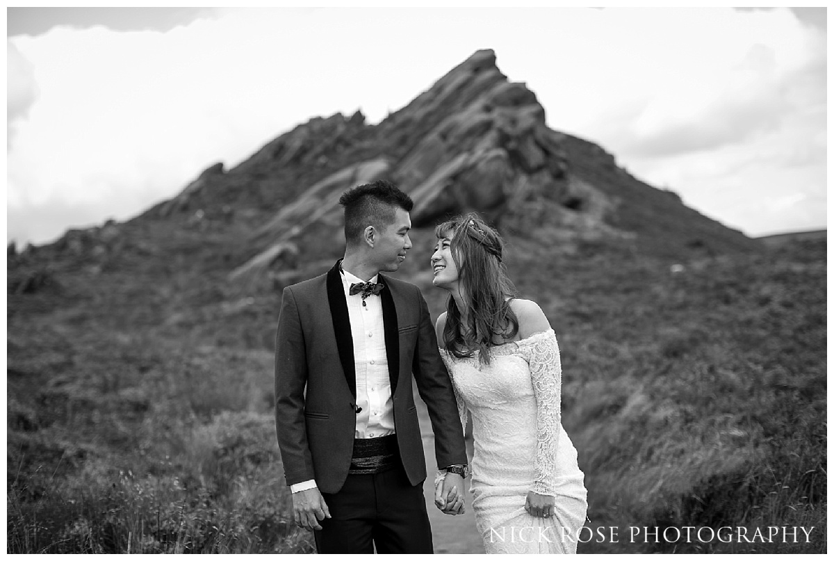 Pre wedding couple holding hands for a photograph at Ramshaw Rocks in the Peak District, Derbyshire