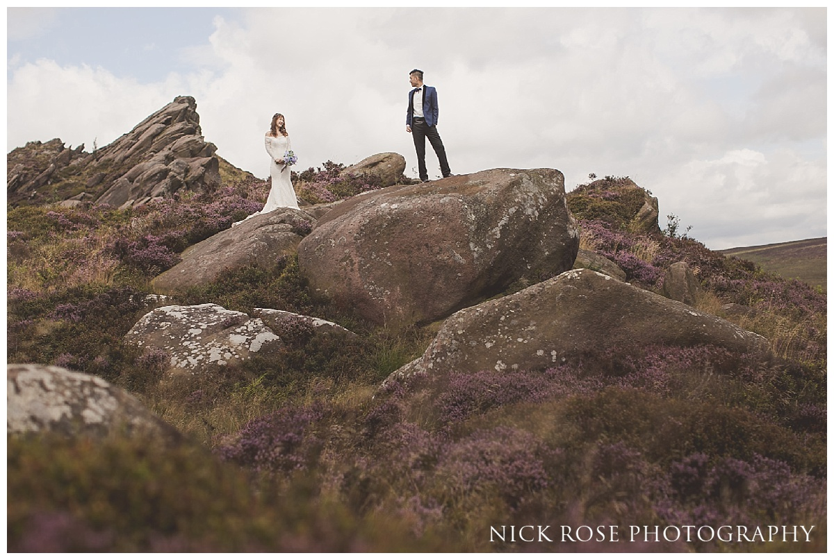 Pre wedding bride and groom standing on Ramshaw Rocks in the Peak District