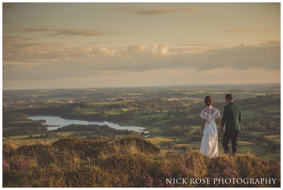 Couple looking over a dramatic view of the Peak District during a pre wedding engagement photography shoot in the Peak District