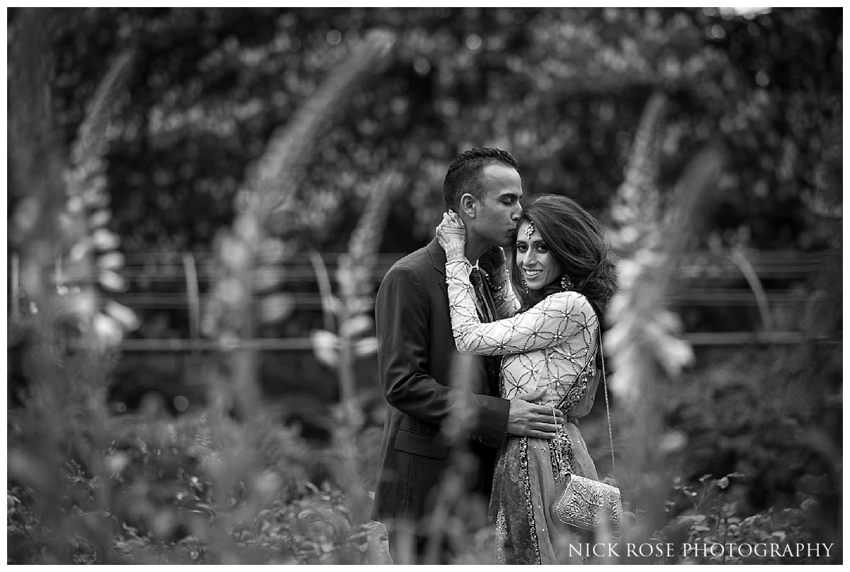 Asian bride and groom embracing in Hyde Park in London for a pre wedding photography portrait