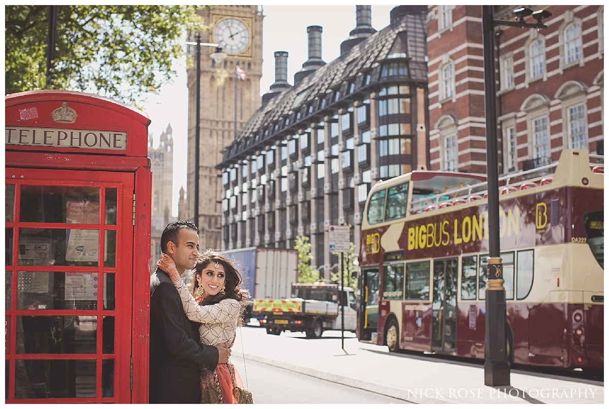 Asian pre wedding photography by red phone boxes in front of Big Ben in London
