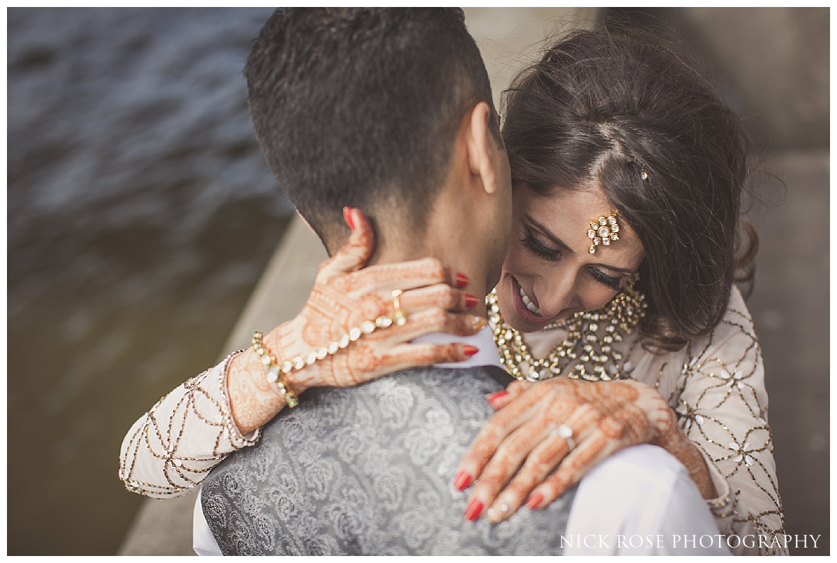 South Asian bride with her arms around Pakistani Groom for a pre wedding photography shoot in London