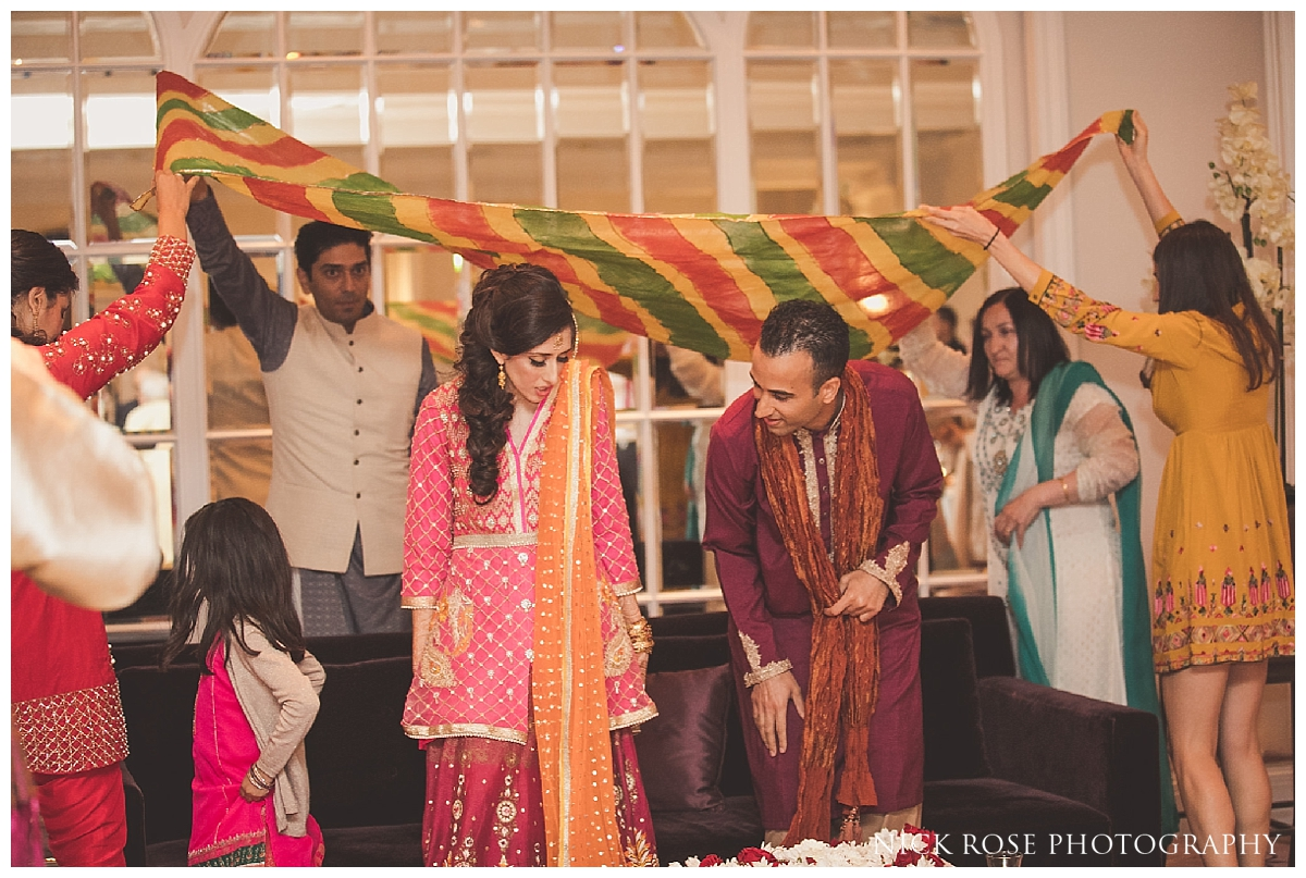 South Asian Rasm blessing during a pre wedding mehndi at the Sheraton Grand in Park Lane