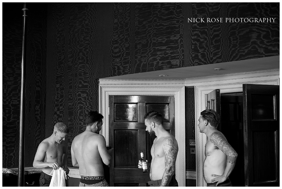 Groom preparation for a Buxted Park hotel wedding in East Sussex