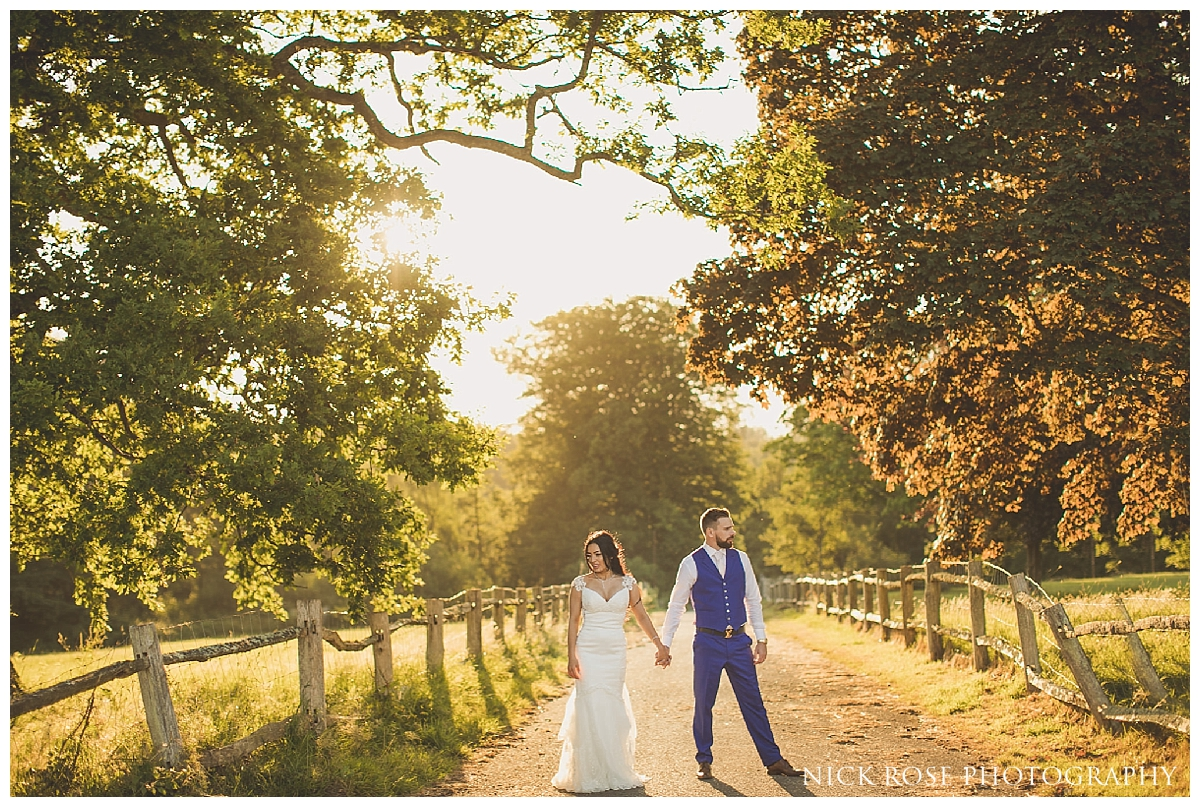 Golden light sunset wedding photography at Buxted Park in East Sussex