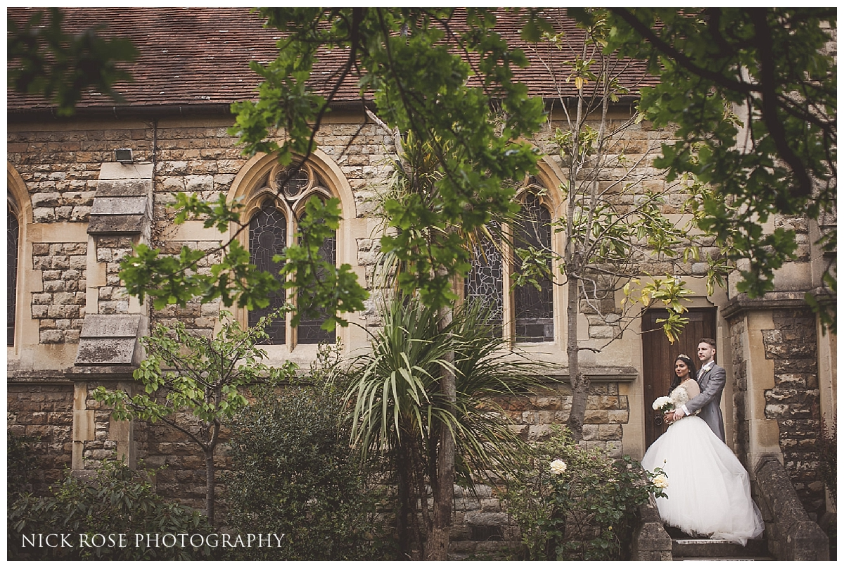 Bride and groom wedding photography portraits after a Catholic wedding ceremony at St Mary Magdalene Church in Enfield London
