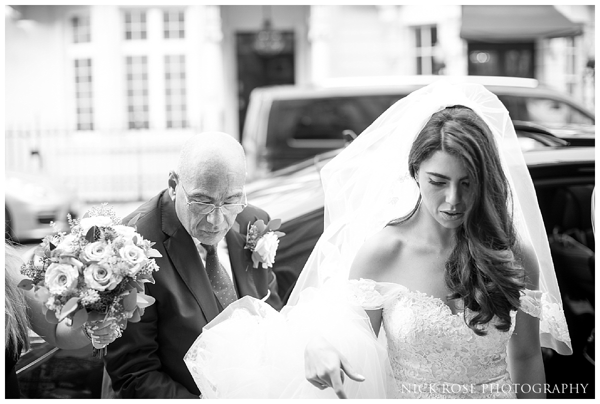 Bride walking up the steps to Dartmouth House in London