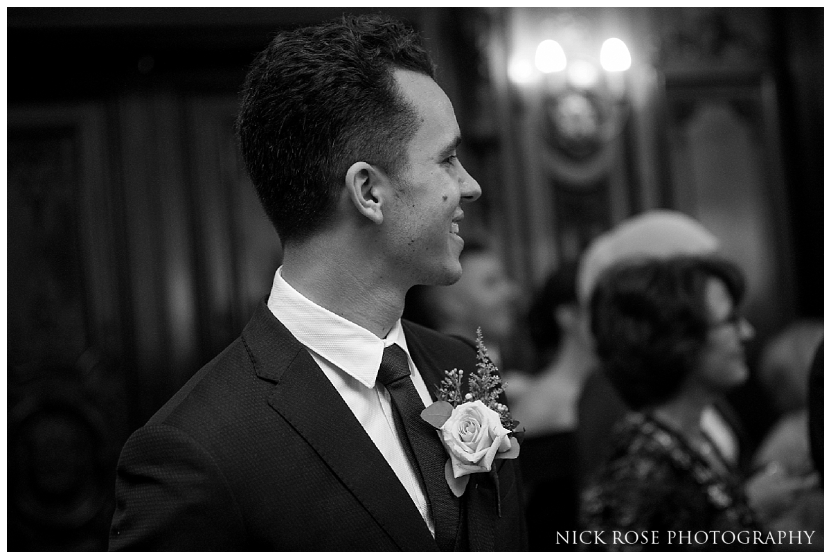 Groom watching bride walk down the Isle for a Mayfair Wedding at Dartmouth House in London