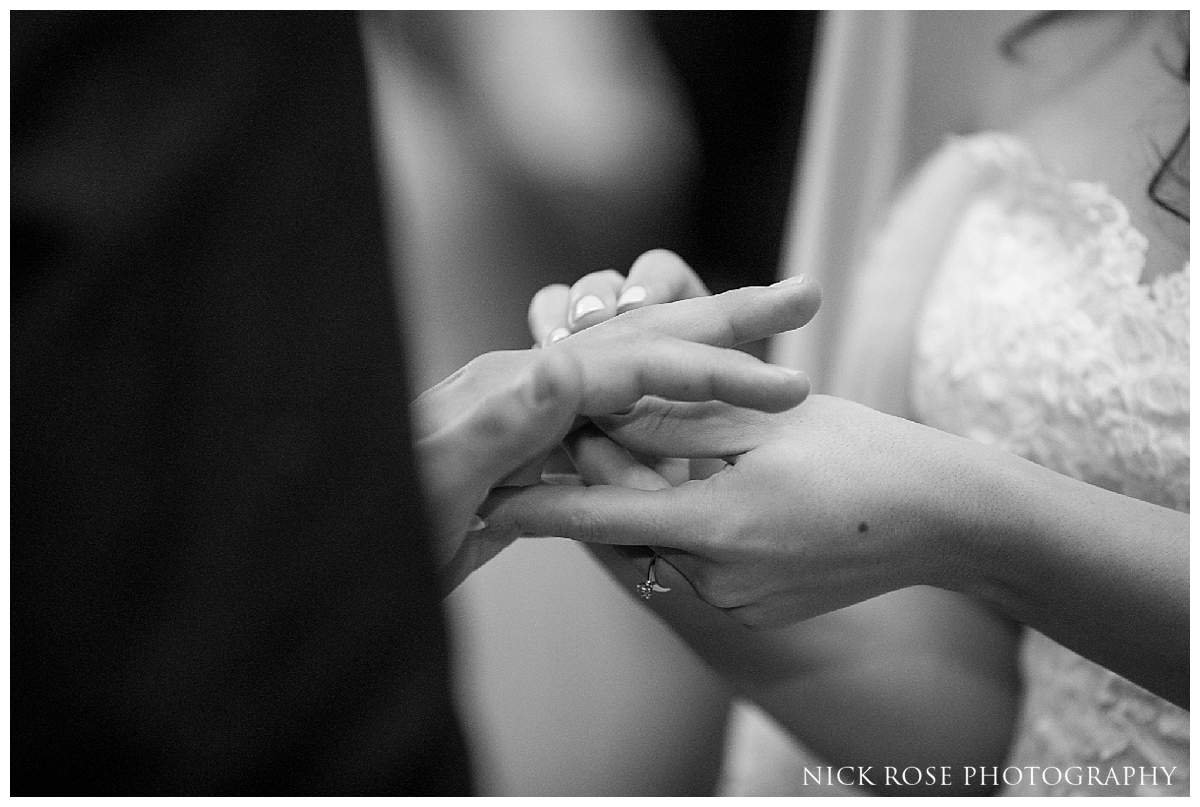 Couple holding hands during a wedding ceremony at Dartmouth House in London's Mayfair