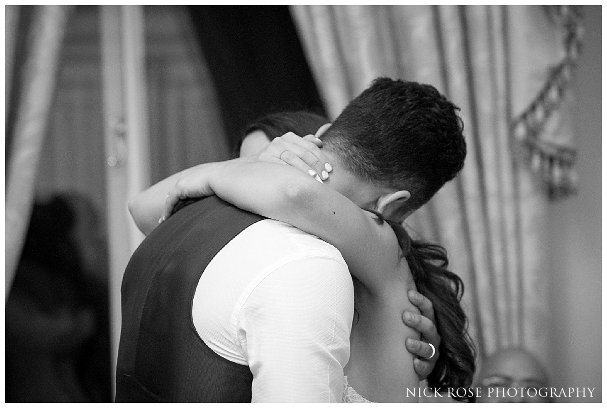 Bride and groom embracing during a Mayfair wedding reception in London
