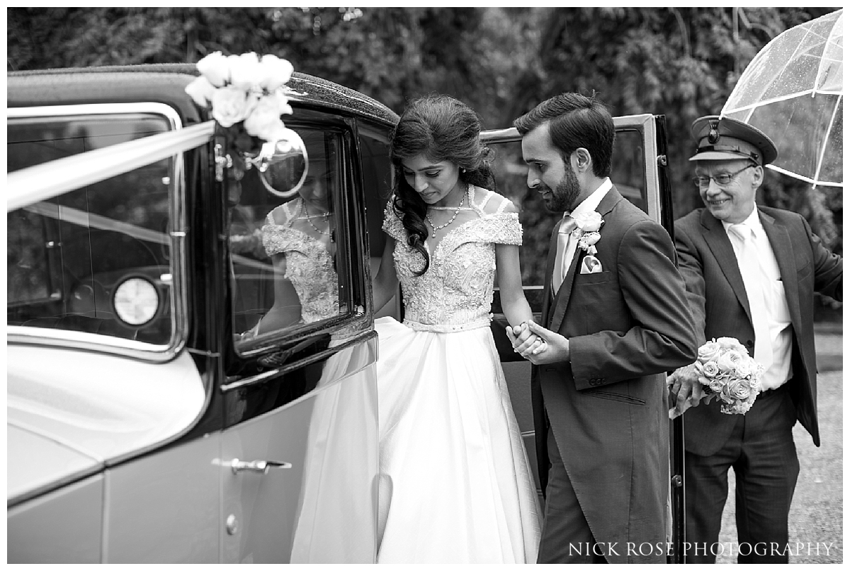 Bride and groom vintage car wedding exit from Waddesdon Manor in Bucks