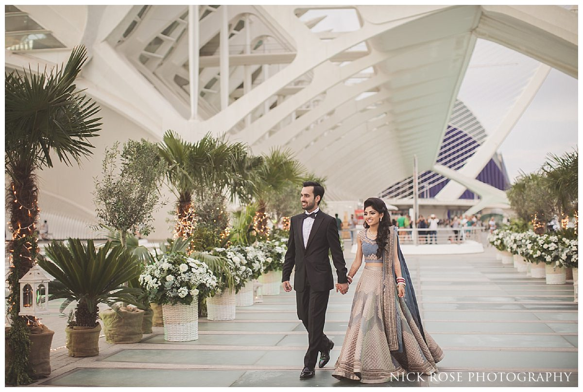 Bride and groom walking into The Hemisfèric, City of Arts in Valencia, Spain for a Sikh wedding reception