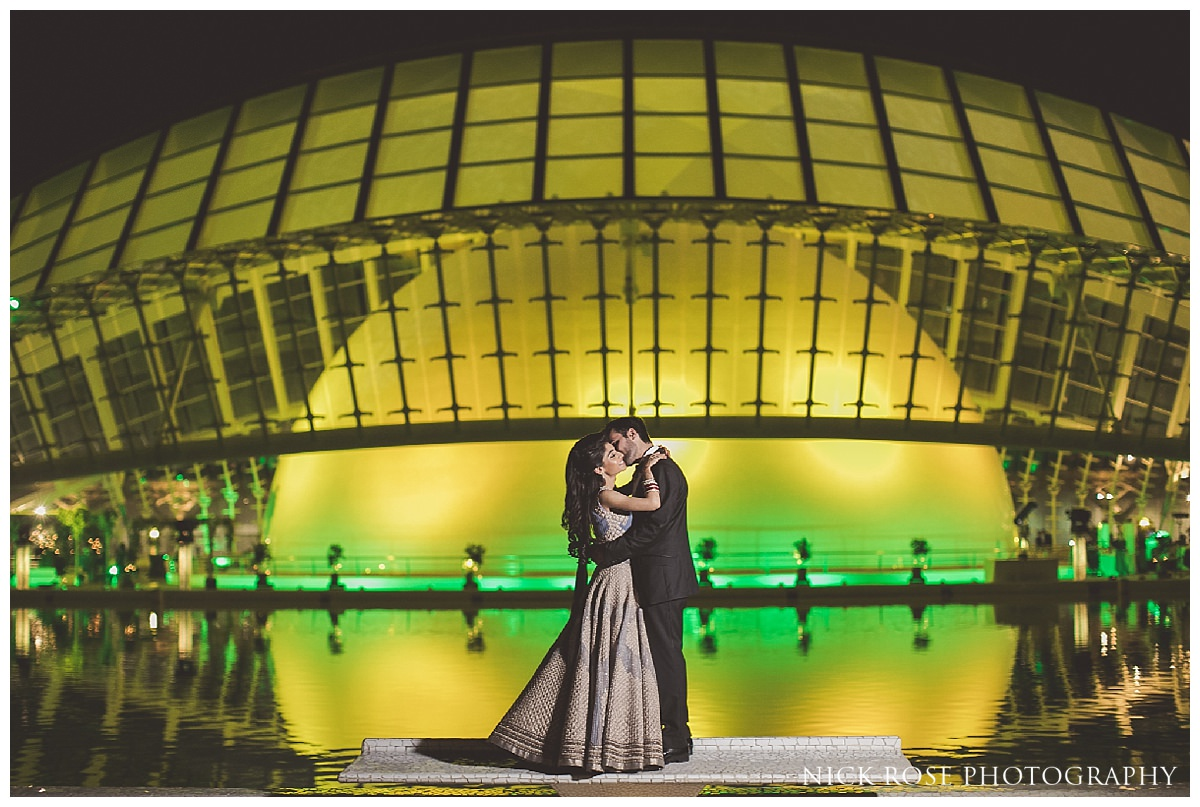 Destination wedding photography portrait in front of the eye of The Hemisfèric in the City of Arts in Valencia, Spain