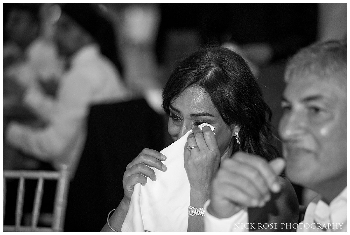 Mother crying during a destination wedding reception in Spain at The Hemisferic