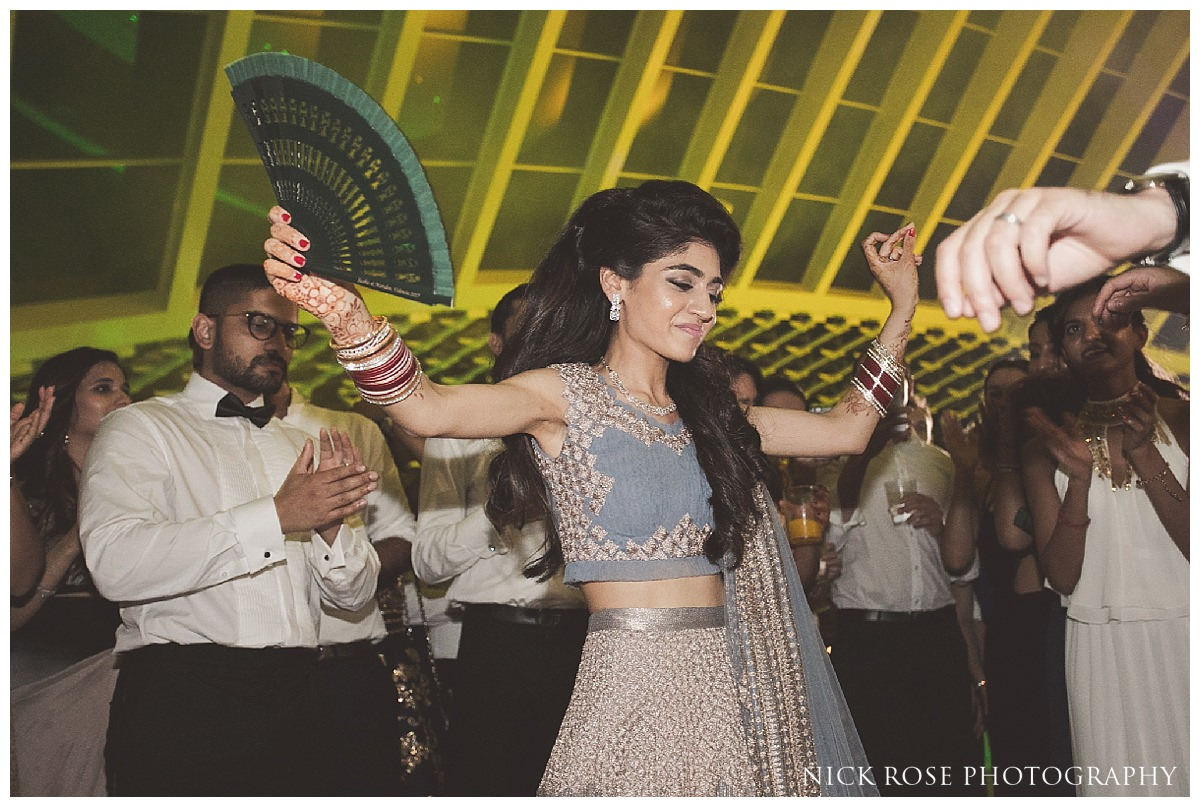 Bride dancing during a Sikh destination wedding at The Hemisfèric, City of Arts in Valencia, Spain
