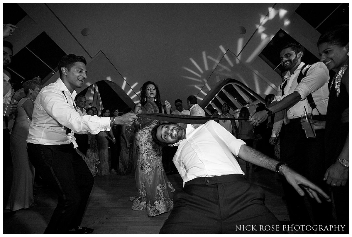 Limbo dancing competition during a fun destination wedding at The Hemisferic in Valencia Spain