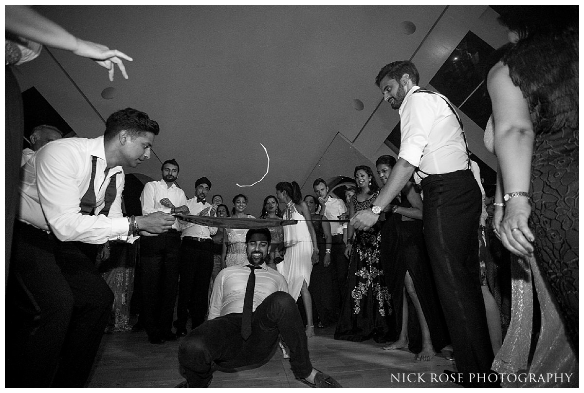 Limbo dancing at a destination wedding at The Hemisferic in Valencia Spain
