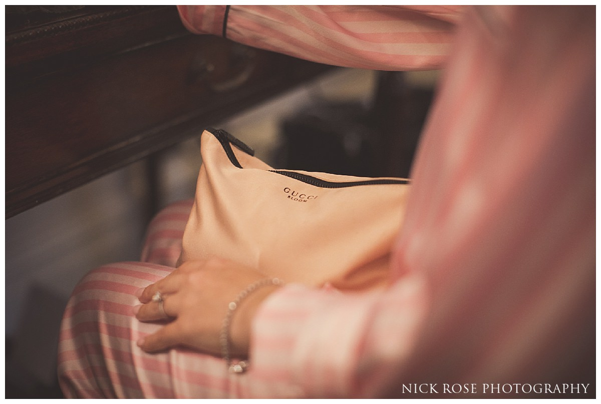 Bride and Gucci makeup bag at The Savoy London