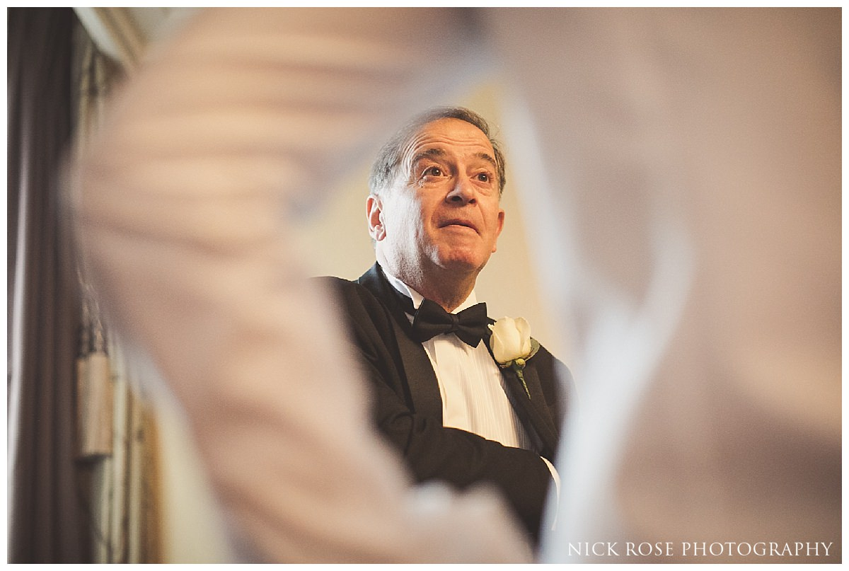 Grooms father preparing for a wedding at The Savoy