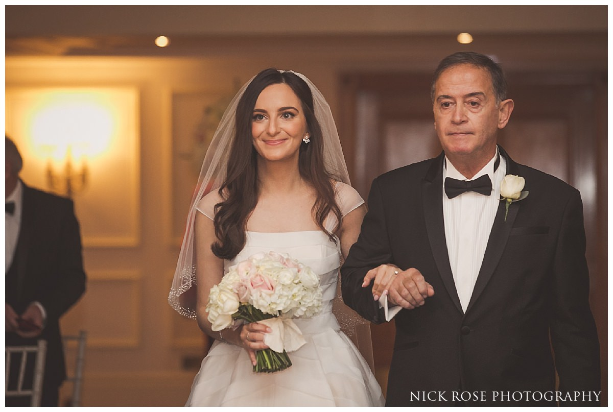 Bride walking down the Isle in the Abraham Lincoln room in the Savoy London