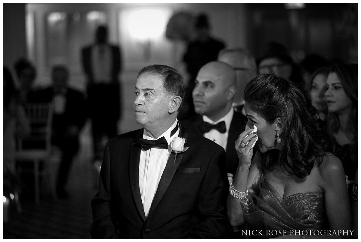 Brides parents looking at bride during a Savoy London wedding ceremony