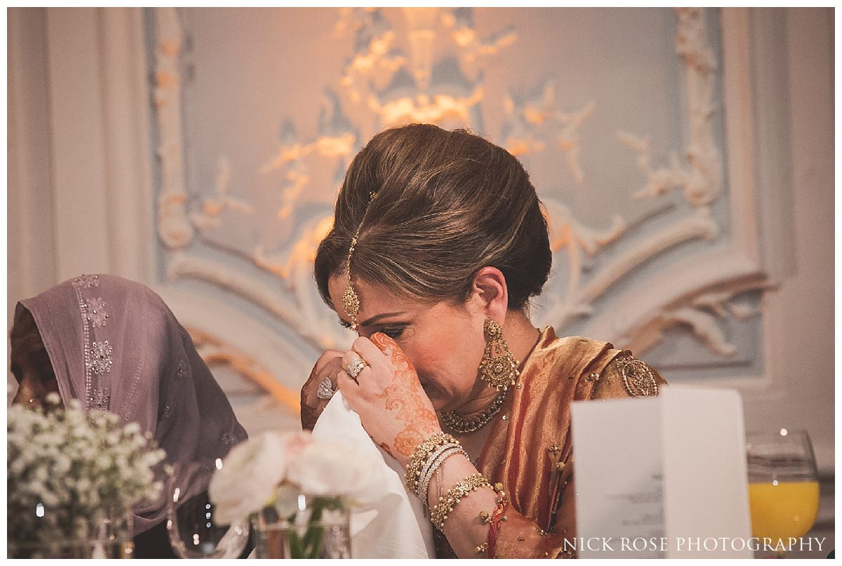 Mother crying during the speeches at a Savoy London wedding