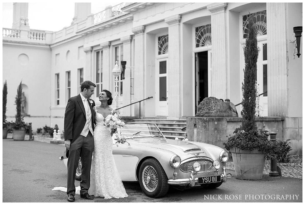 Bride and groom wedding photographs at Stoke Park Hotel in Buckinghamshire
