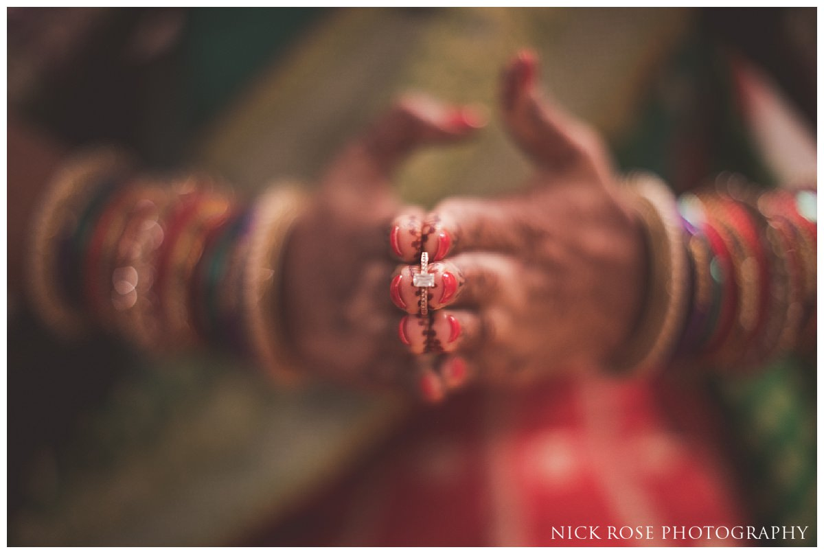 Hindu bride holding her wedding ring before an Indian wedding at the Oshwal Centre in Potters Bar London