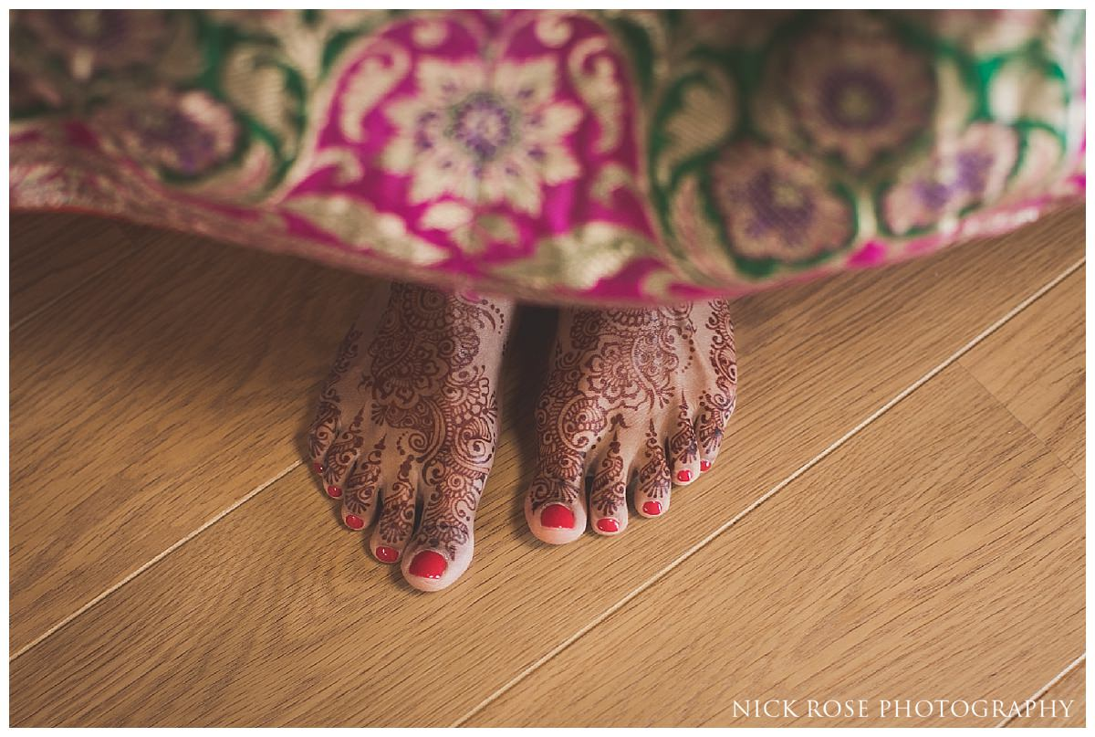 Indian bride's feet with henna on