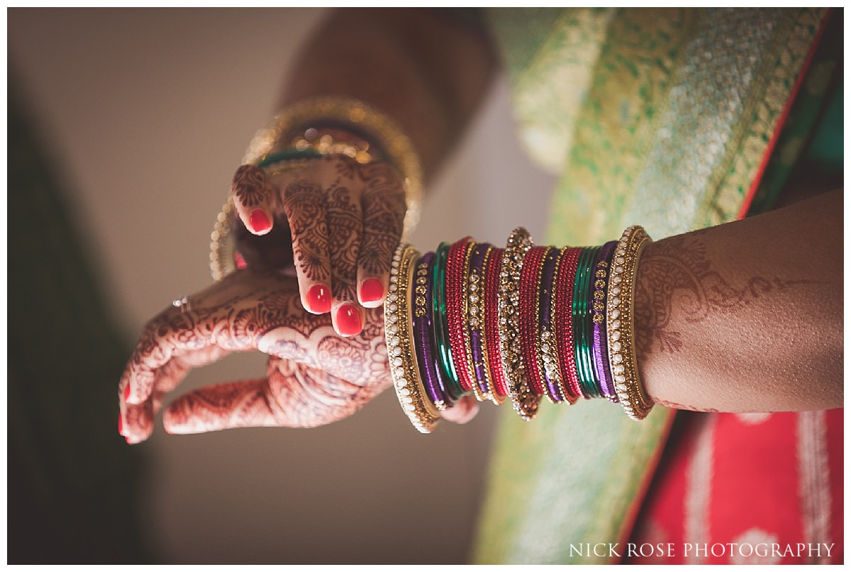 Indian bride putting on bangles before a Hindu wedding in Potters Bar
