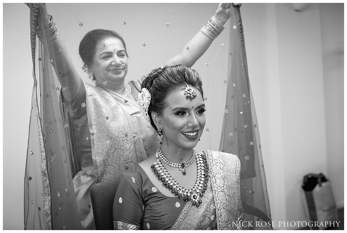 Mother putting on Chunni before a hindu wedding