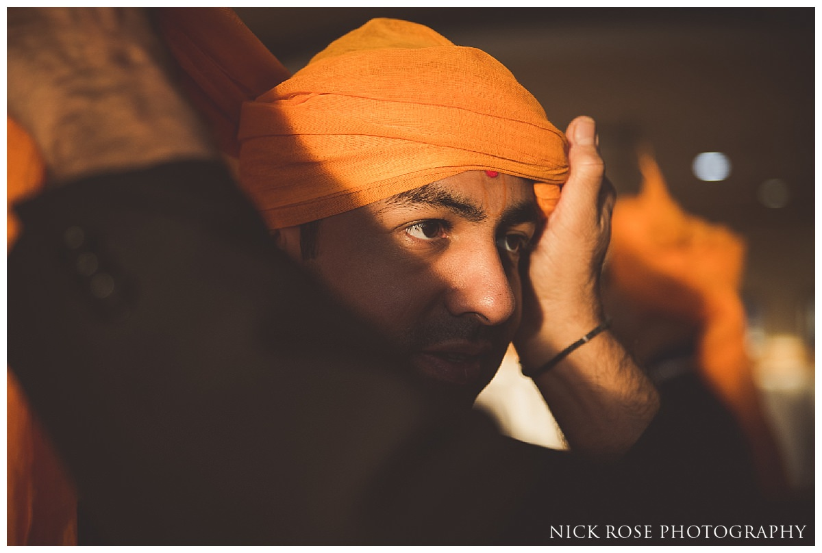 Groom preparations at the Oshwal Centre for a Hindu wedding in Hertfordshire