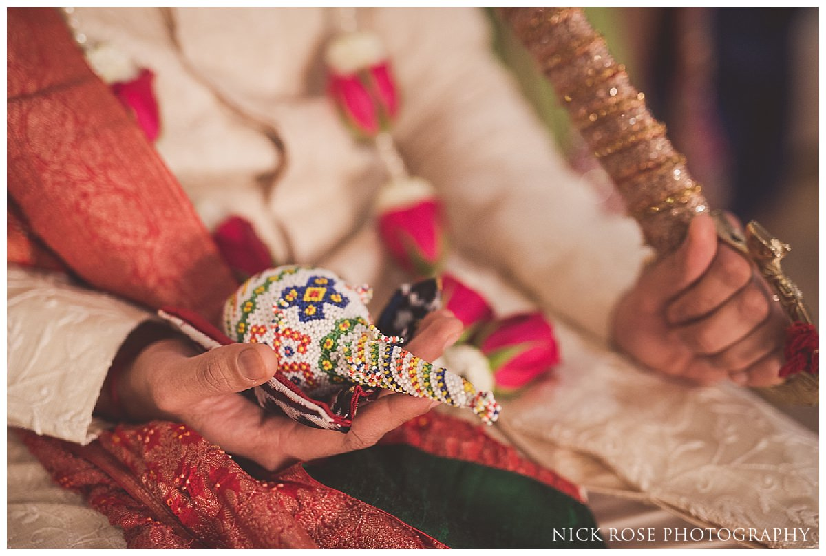 Groom hindu religious ceremony before a Hertfordshire Indian wedding at the Oshwal Centre