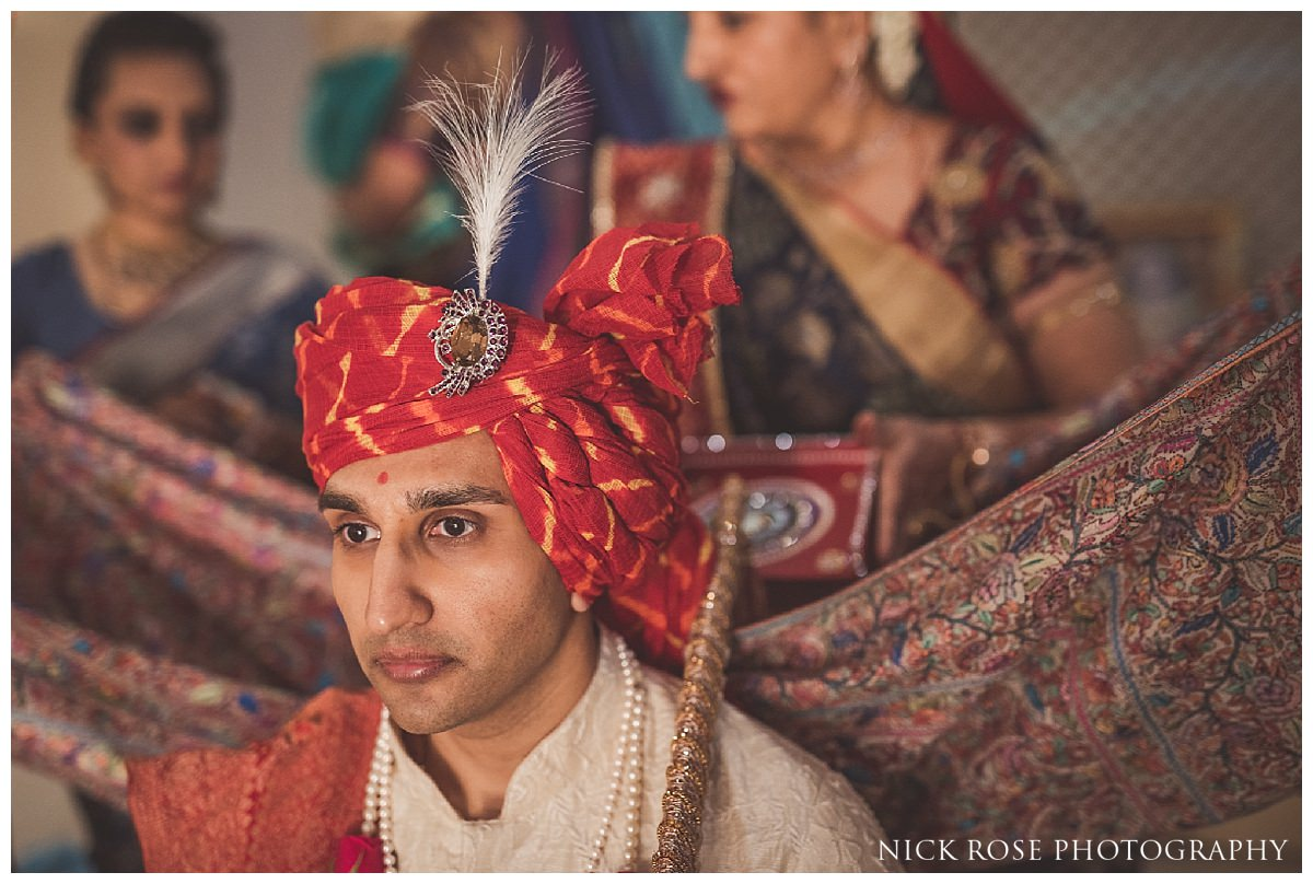 Groom turban tying before a Hertfordshire Indian wedding at the Oshwal Centre