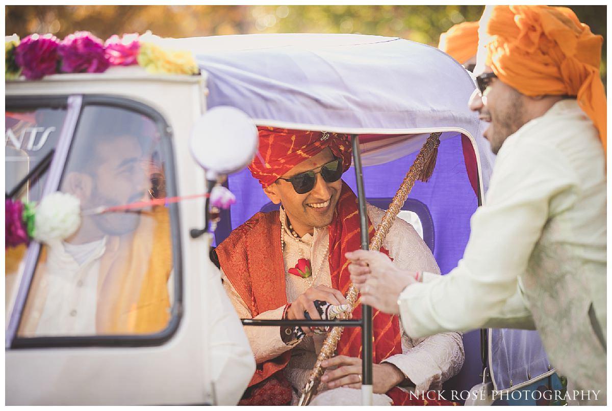 Hindu wedding baraat on an Indian rickshaw at the Potters Bar Oshwal Centre in Hertfordshire