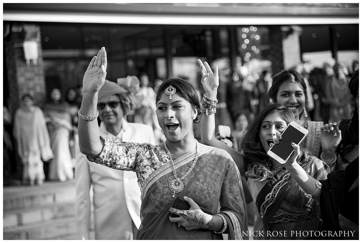 Hindu wedding baraat entrance and dancing at the Potters Bar Oshwal Centre in Hertfordshire