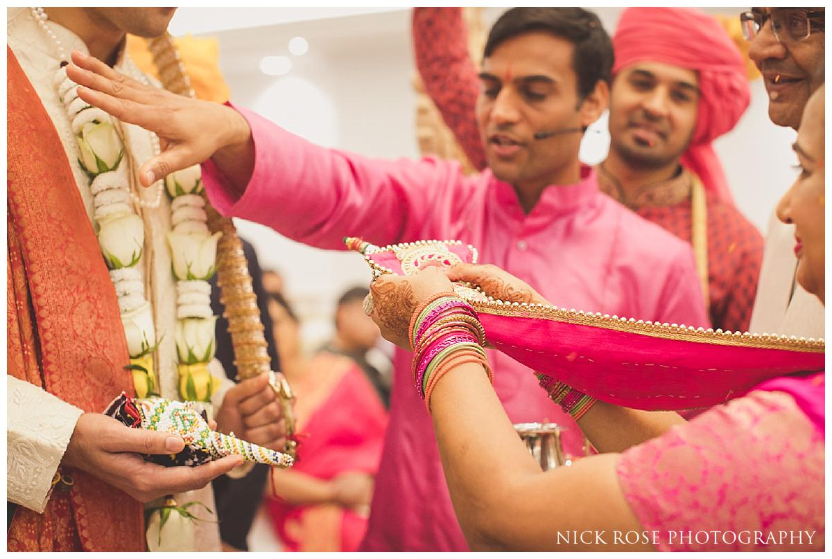 Indian wedding ceremony with hindu priest Kamal Pandey at the Potters Bar Oshwal Centre in Hertfordshire