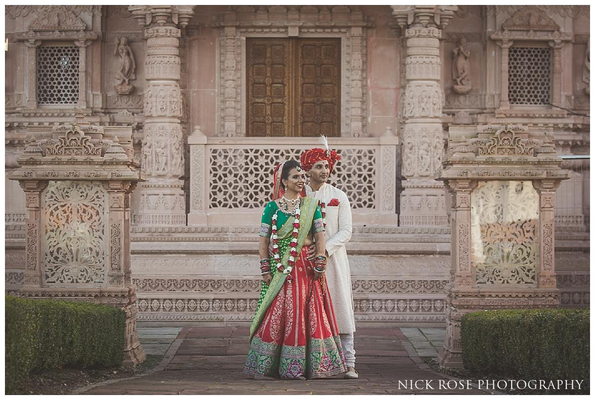 Indian bride and groom wedding photography portrait at the Oshwal Centre in Potters Bar