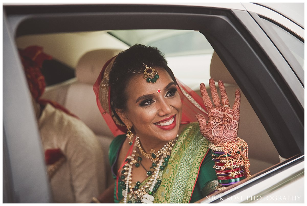 Hindu bride says goodbye to family after an Indian wedding in Hertfordshire