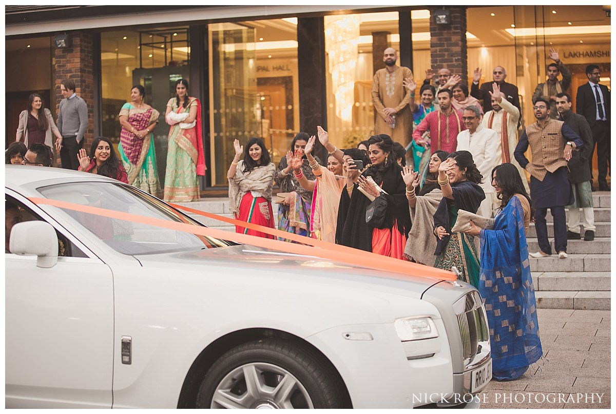 Hindu couple says goodbye to family after an Indian wedding in Hertfordshire