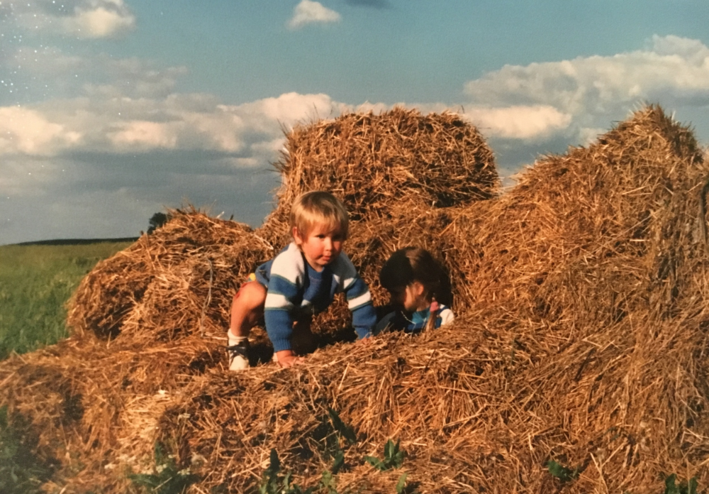 Dylan and Olga playing in a haystack