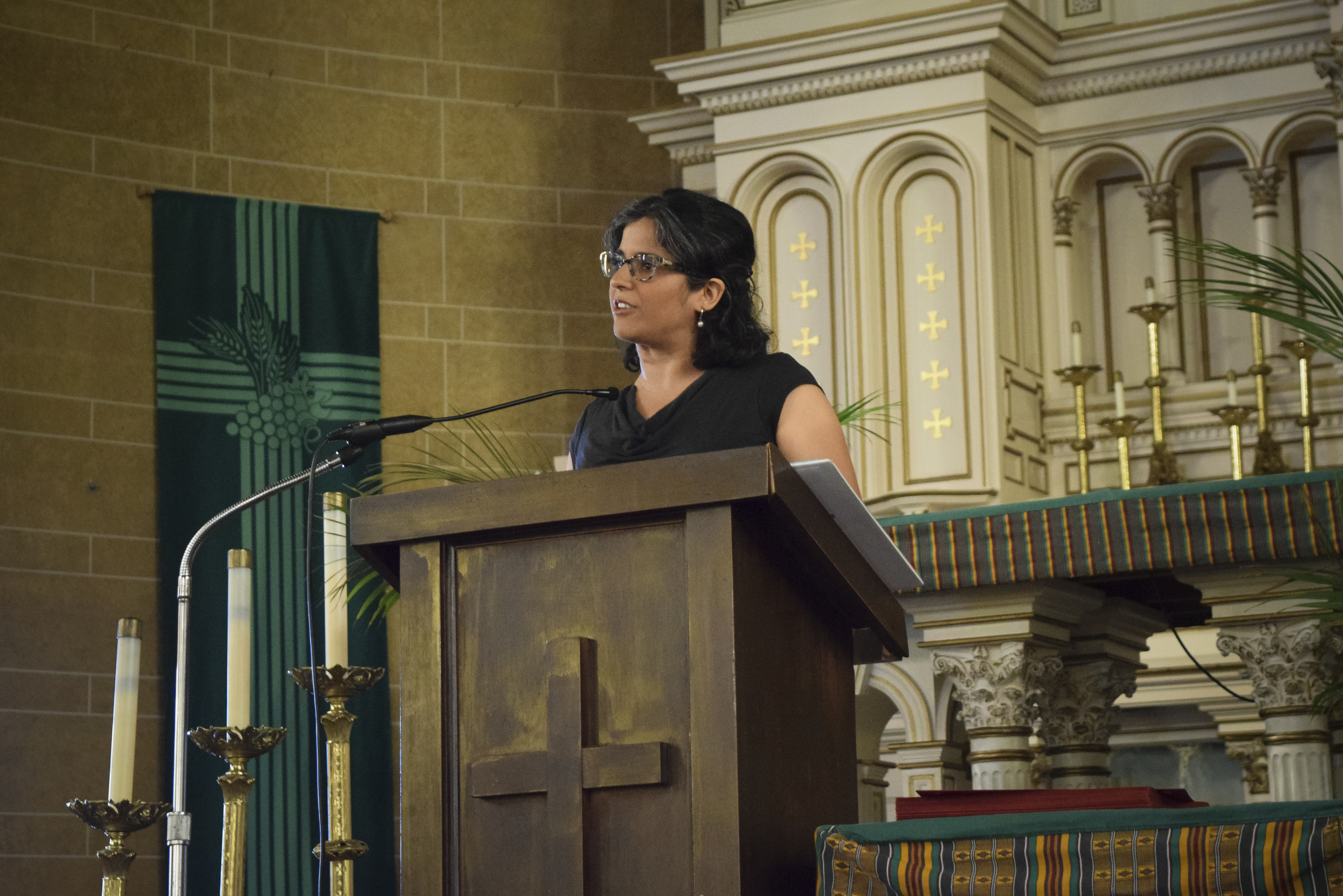 Ms. Nisha addresses the graduates, families, and friends.
