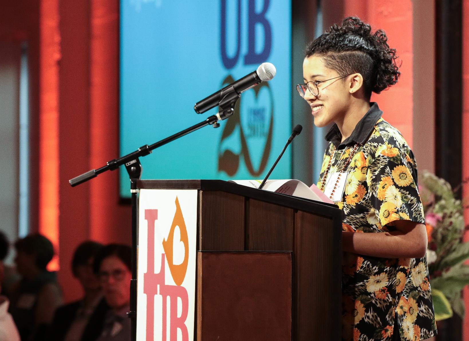 Azura Tyabji '14, performing her poem  for female revolution, for girls
