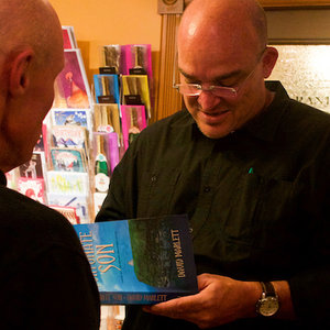 David Marlett signing copies of FORTUNATE SON at a reading.