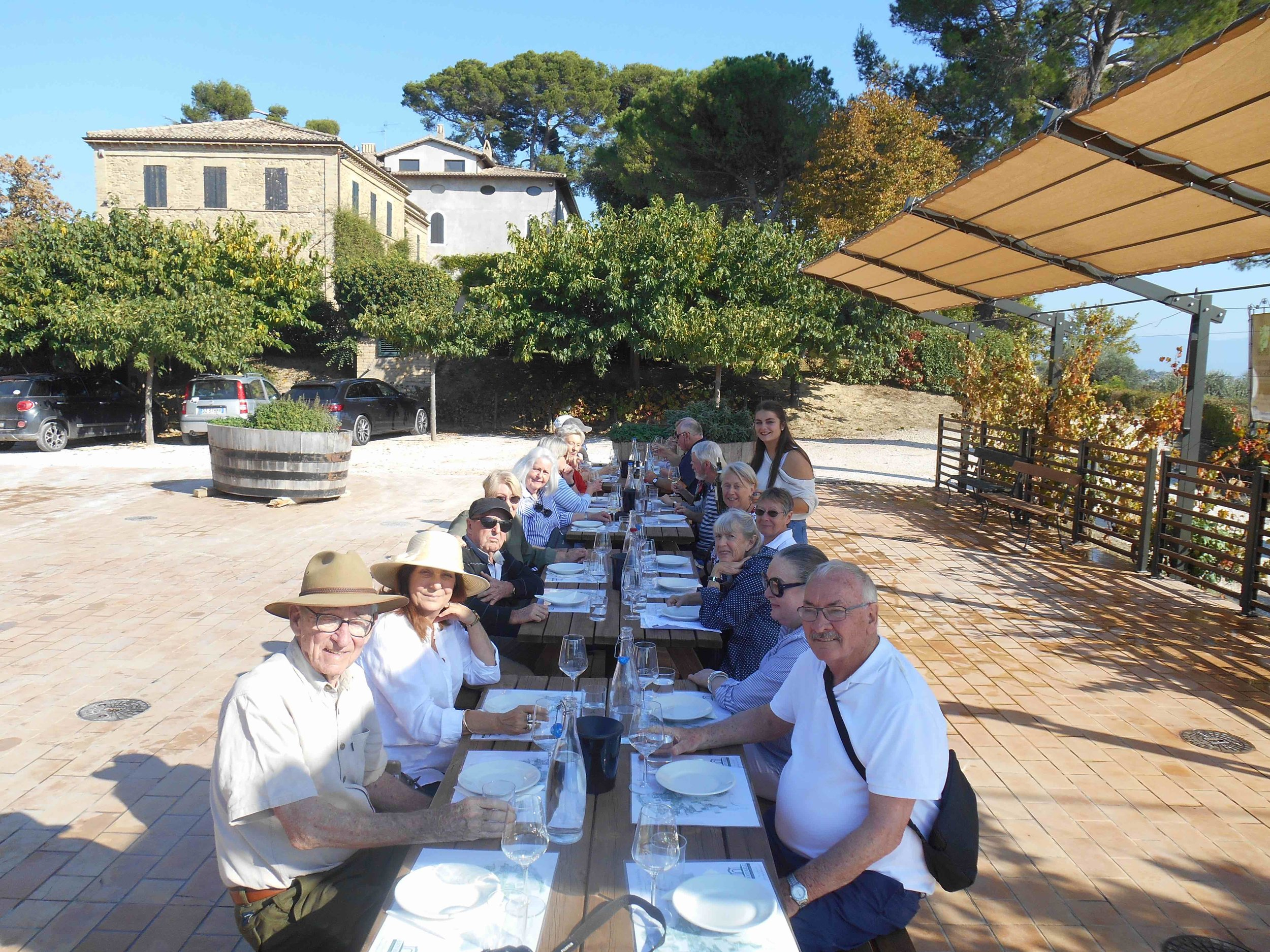 Frank and Mary - first 2 tour participants seated in the right row, enjoying a long lazy lunch on their 2018 'Enchanting Italy Uncovered' Tour