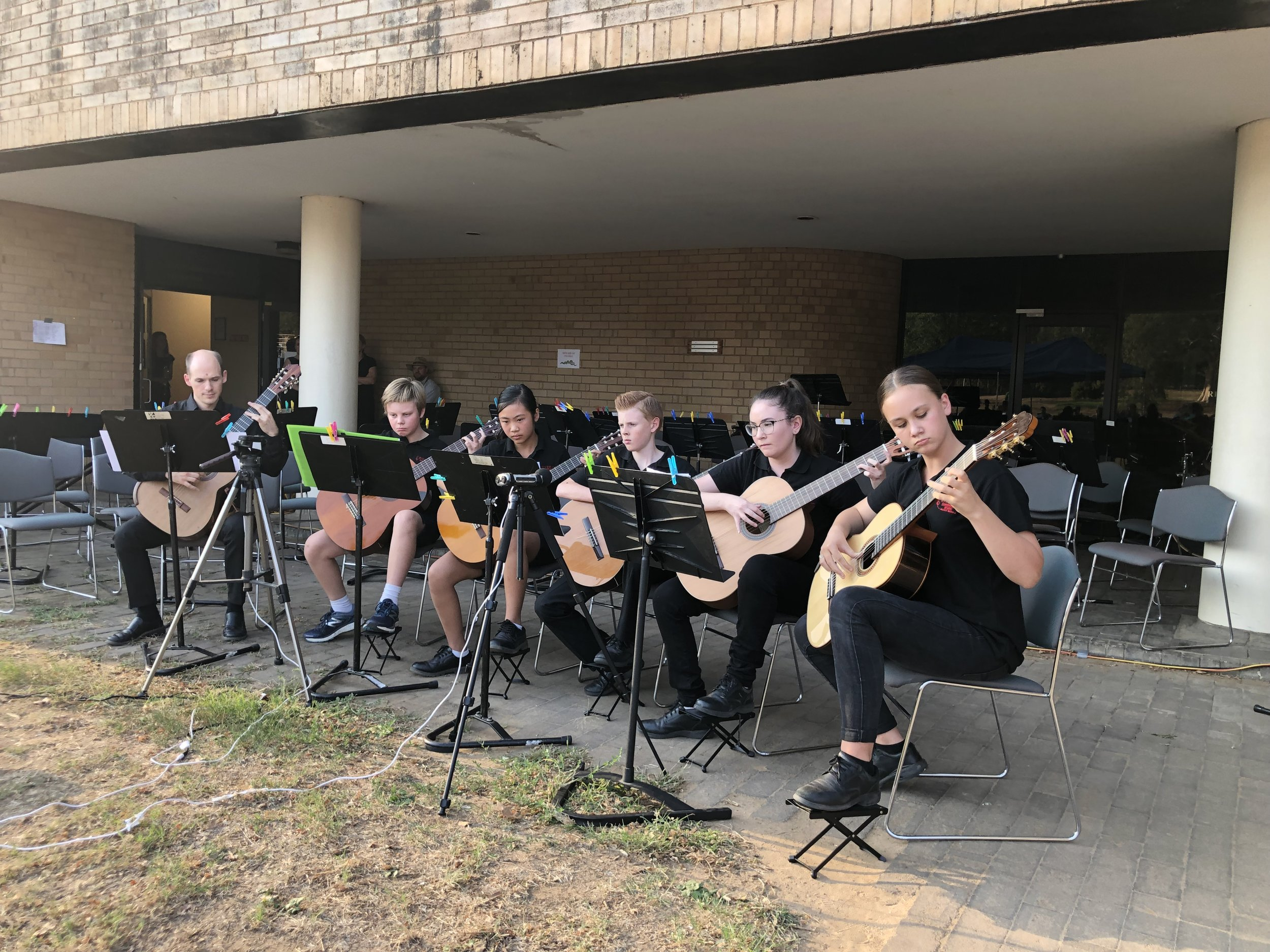Guitarists Breakfast recently performing at the RCM Outdoor Ensembles Concert in March 2019.