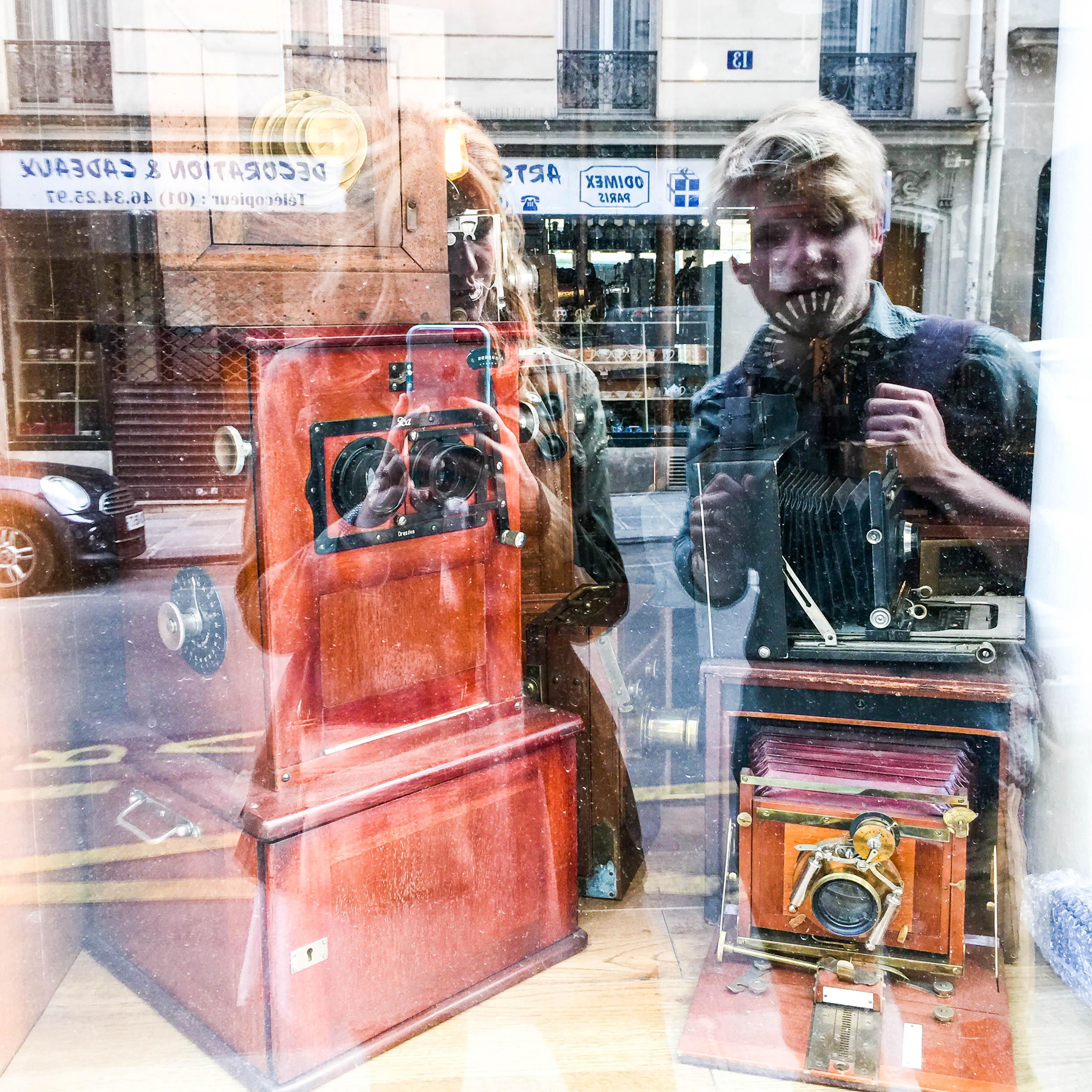 I love our reflections in this vintage camera shop window.