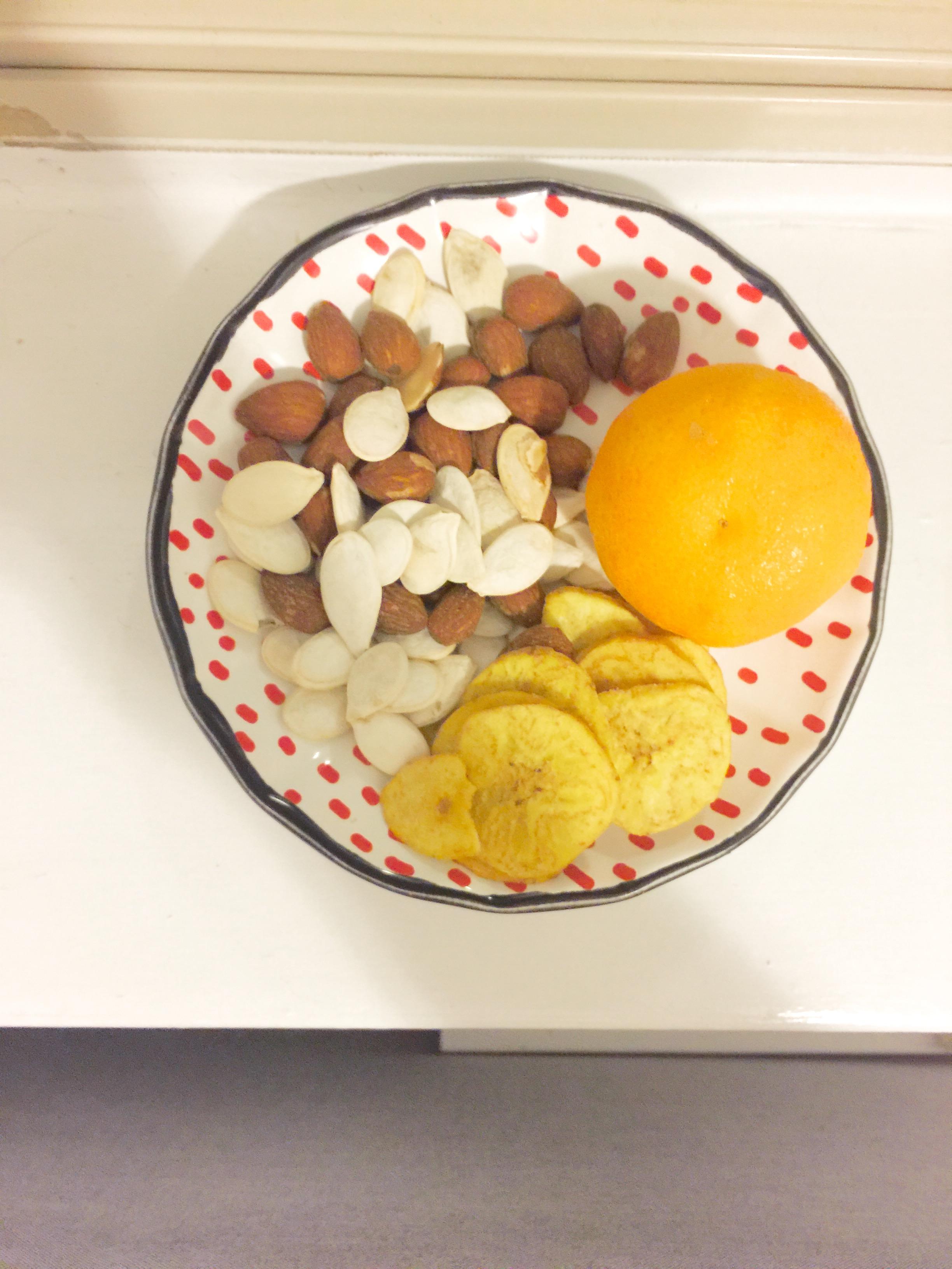 Almonds, pumpkin seeds, and a cutie orange