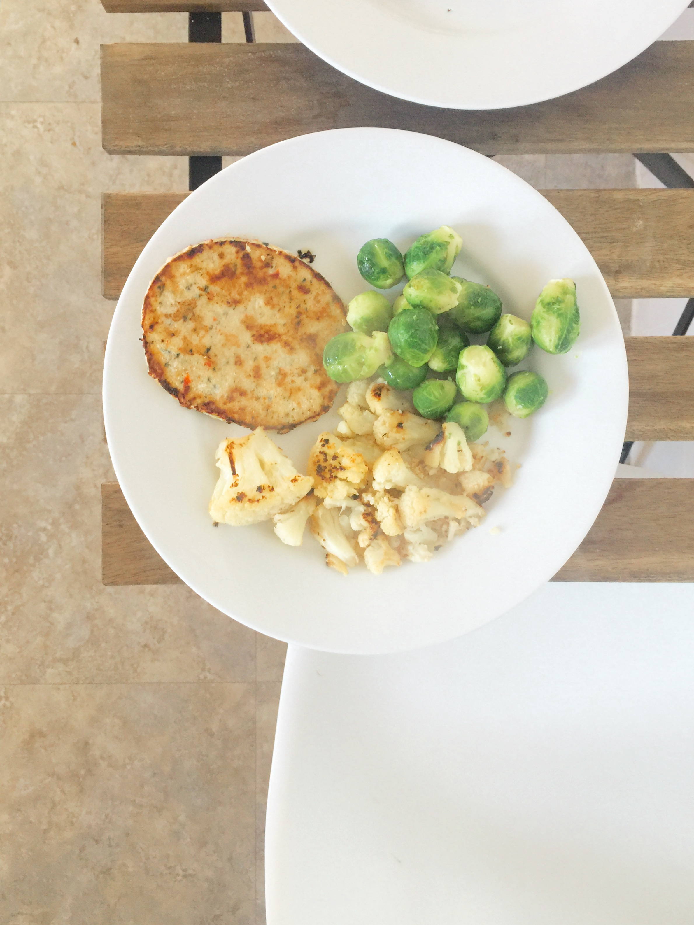 Trader Joe's Chili Lime Chicken Burger, Trader Joe's Grilled Cauliflower, and Brussels Sprouts. I used spicy mustard for dipping.